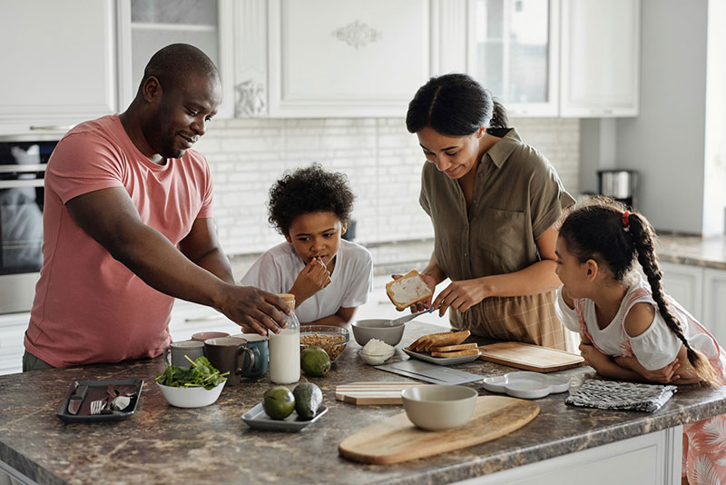 Image of a family preparing a meal.
